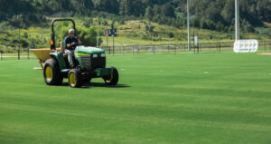 Image of a tractor preparing Sports Turf