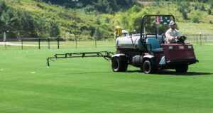 Image of an ATV spraying Sports Turf